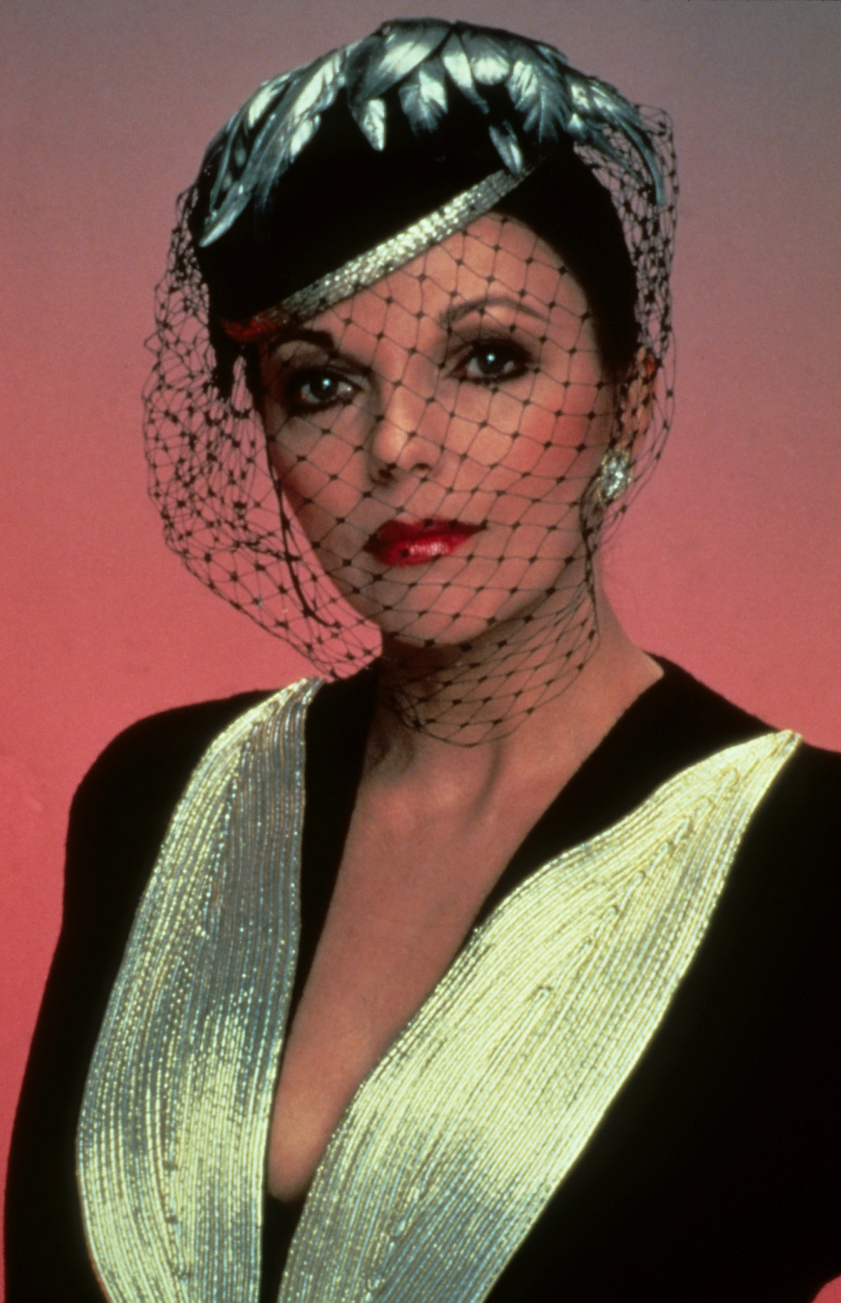 Joan Collins with hat