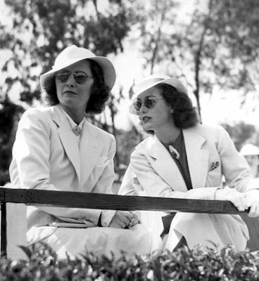 Stanwyck and Crawford in matching mannish attire, circa late 1930s.