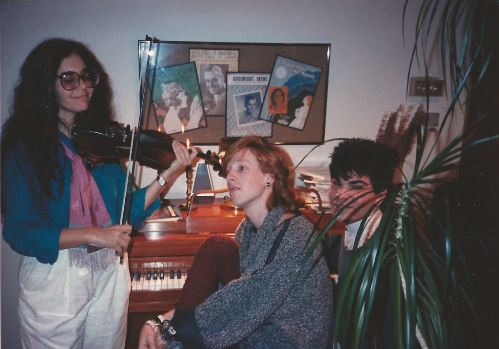 "Christmas, 1985 at our house. Cousin Roni on the violin. Steven and I spent a lot of time at this piano singing the hits of the day like Madonna's ""Crazy For You"" in our old lady voices until we would collapse in heaps of laughter."